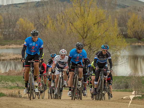 Dr. Nick (in white) rides in the Buff Gold Circuit race in Boulder.
